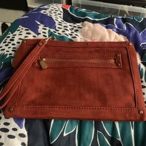 Express rust colored suede-like clutch wristlet